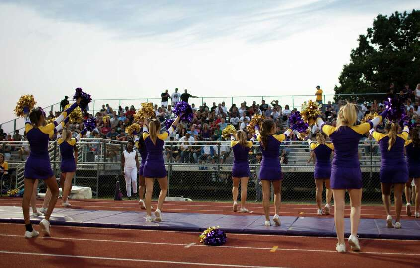 Troy High cheerleaders do a cheer for the home crowd during the football game against Burnt Hills Fr