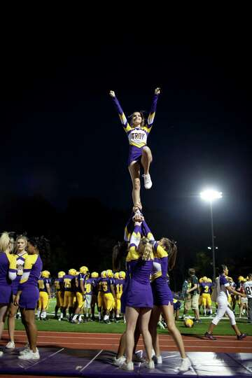 Troy High cheerleaders perform for the home crowd during the football game against Burnt Hills Frida