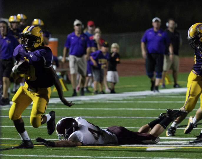 Troy High player #20 breaks a tackle to score a touchdown during the football game against Burnt Hil