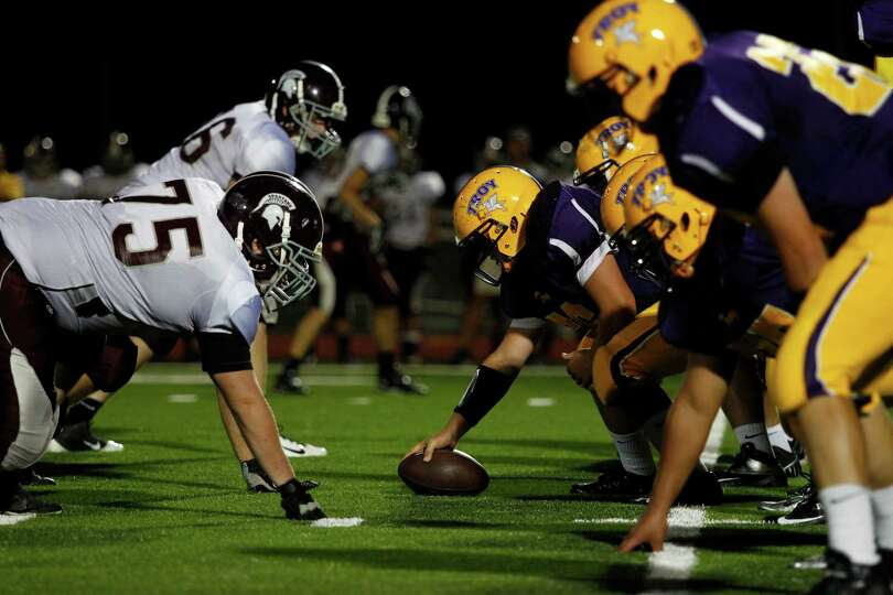 Troy High offense faces off against Burnt Hills during the game Friday evening, Aug. 31, 2012 in Tro