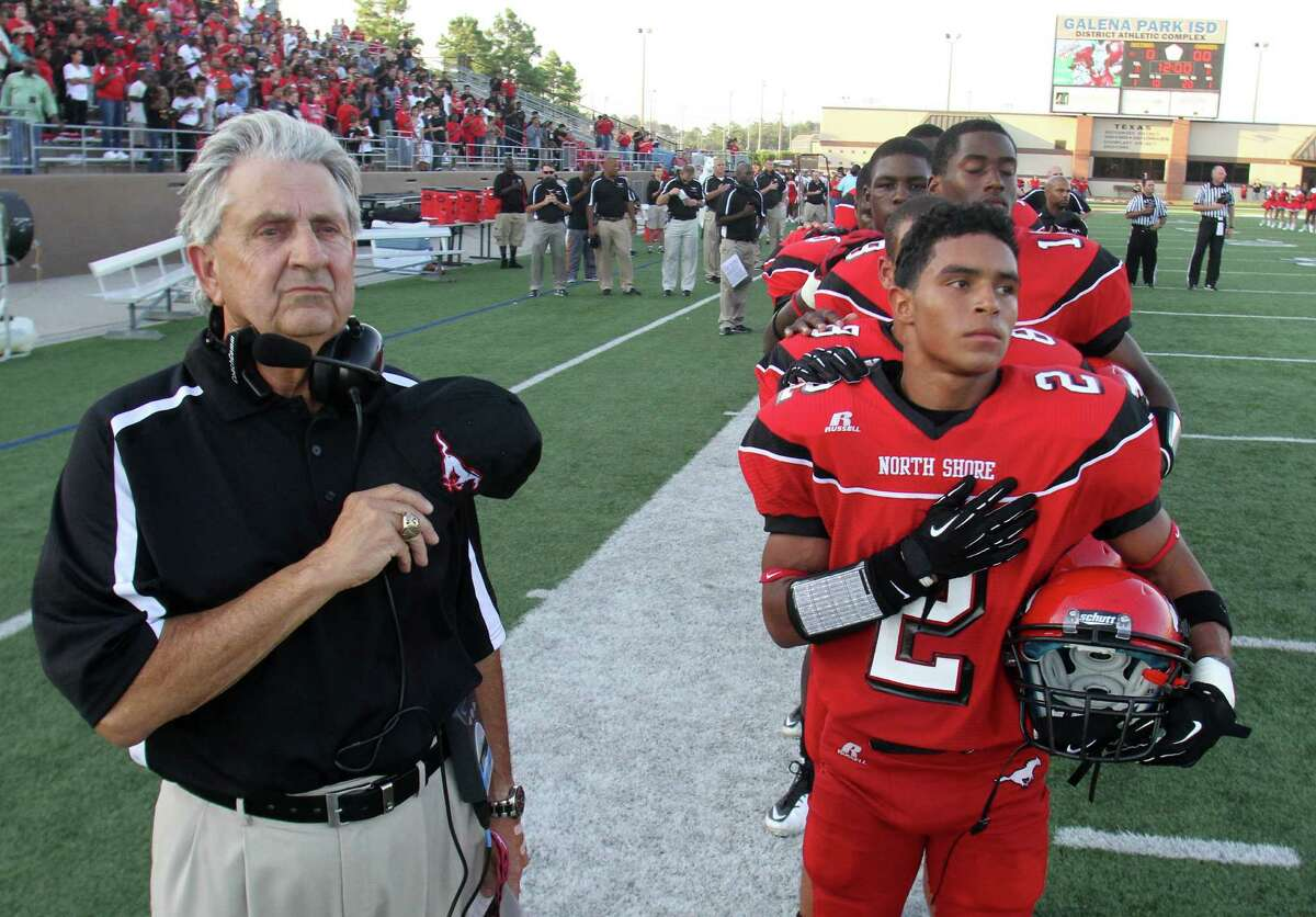 North Shore head football coach David Aymond and North Shore running back Kevian DeLeon (2) stand for the national anthem as they prepare to face Clear Springs at the Galena Park Athletic Complex on Friday, Aug. 31, 2012, in Houston.