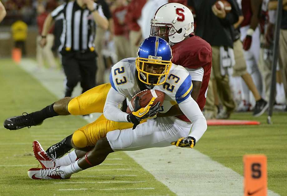 Barry Browning tried to contain San Jose State's Noel Grigsby on Aug. 31. USC is even better. Photo: Thearon W. Henderson, Getty Images
