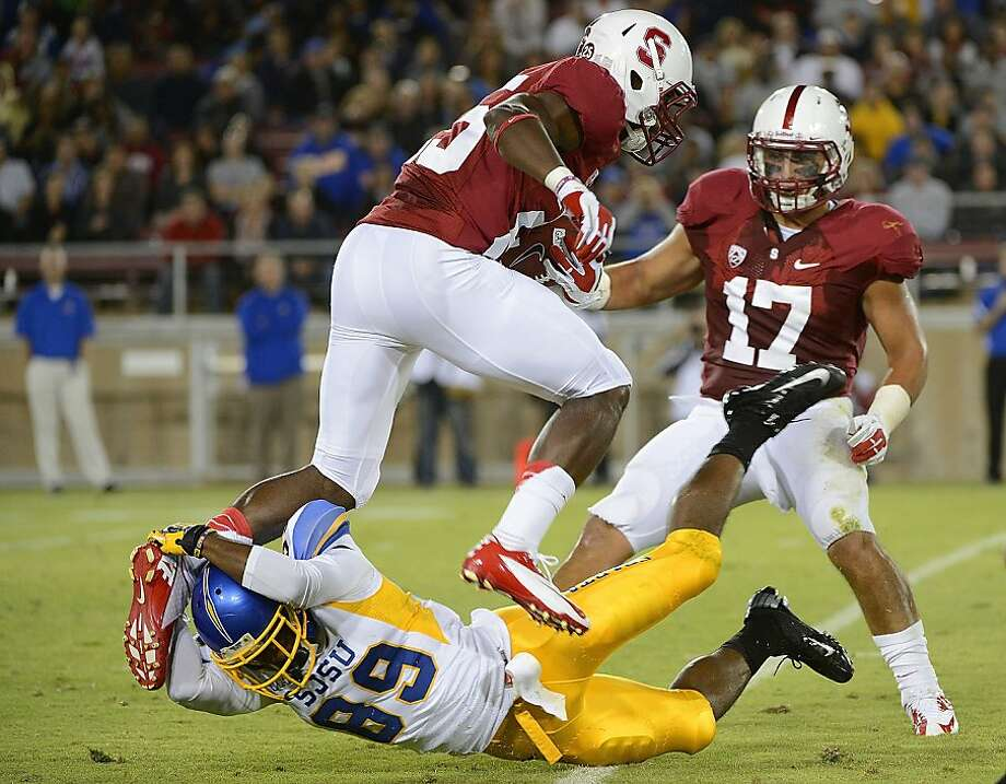 Alex Carter #25 of Stanford University gets tackled on a kickoff by Chandler Jones #89 of San Jose State University in the second quarter during an NCAA football game at Stanford Stadium on August 31, 2012 in Palo Alto, California. (Photo by Thearon W. Henderson/Getty Images) Photo: Thearon W. Henderson, Getty Images