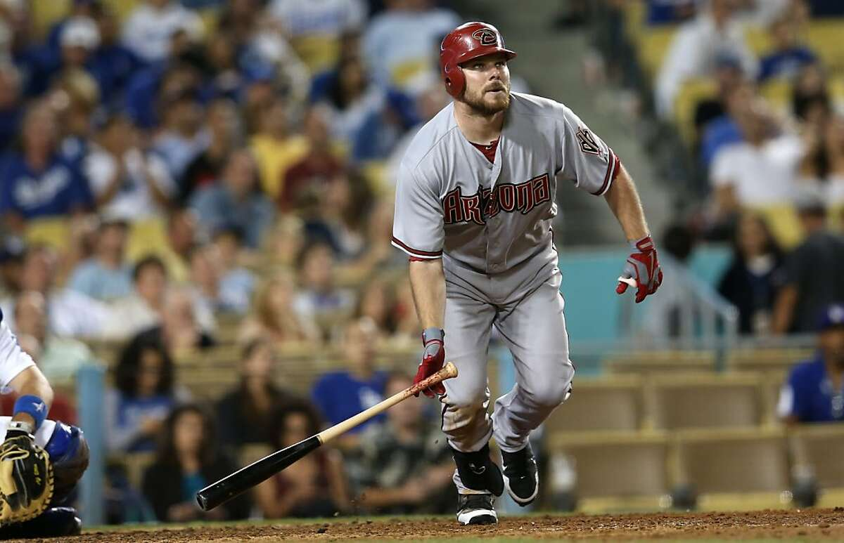 LOS ANGELES, CA - AUGUST 31: Jason Kubel #13 of the Arizona Diamondbacks watches his solo home run in the 11th inning to give the Diamondbacks the lead against the Los Angeles Dodgers on August 31, 2012 at Dodger Stadium in Los Angeles, California. (Photo by Stephen Dunn/Getty Images)