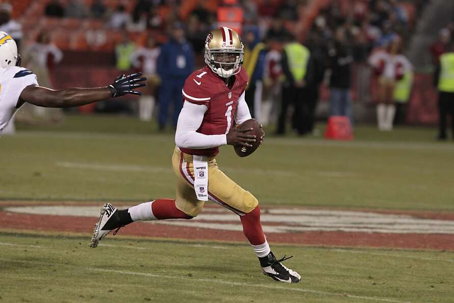 Josh Johnson rolls out for a pass as the 49ers beat. the San Diego Chargers at Candlestick Park in S