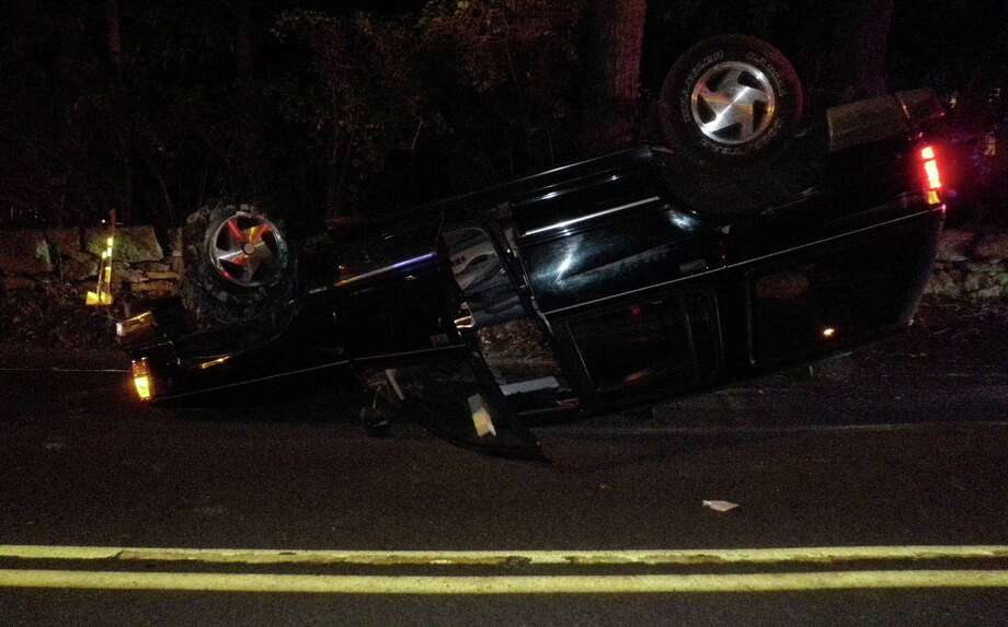 This car rolled over in a single-vehicle mishap Friday night on Saugatuck Avenue. Photo: Westport Fire Department / Westport News contributed