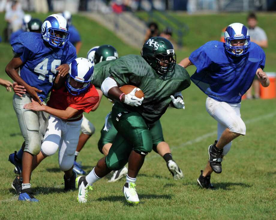 Norwalk's Tomar Joseph plays against Port Chester during the High School Football Jamboree at Veterans Memorial Stadium in Wilton on Saturday, September 1, 2012. Photo: Lindsay Niegelberg / Stamford Advocate