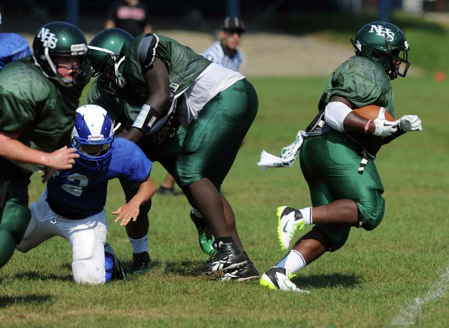 Norwalk's Tomar Joseph plays against Port Chester during the High School Football Jamboree at Veterans Memorial Stadium in Wilton on Saturday, September 1, 2012.