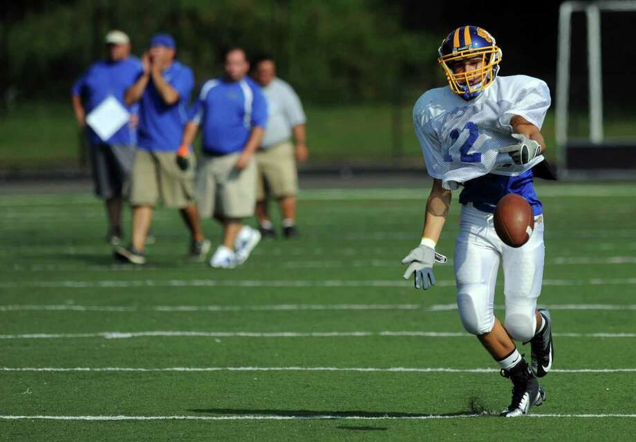 Brookfield's Nick Biasetti warms up during the High School Football Jamboree at Veterans Memorial Stadium in Wilton on Saturday, September 1, 2012. Photo: Lindsay Niegelberg / Stamford Advocate