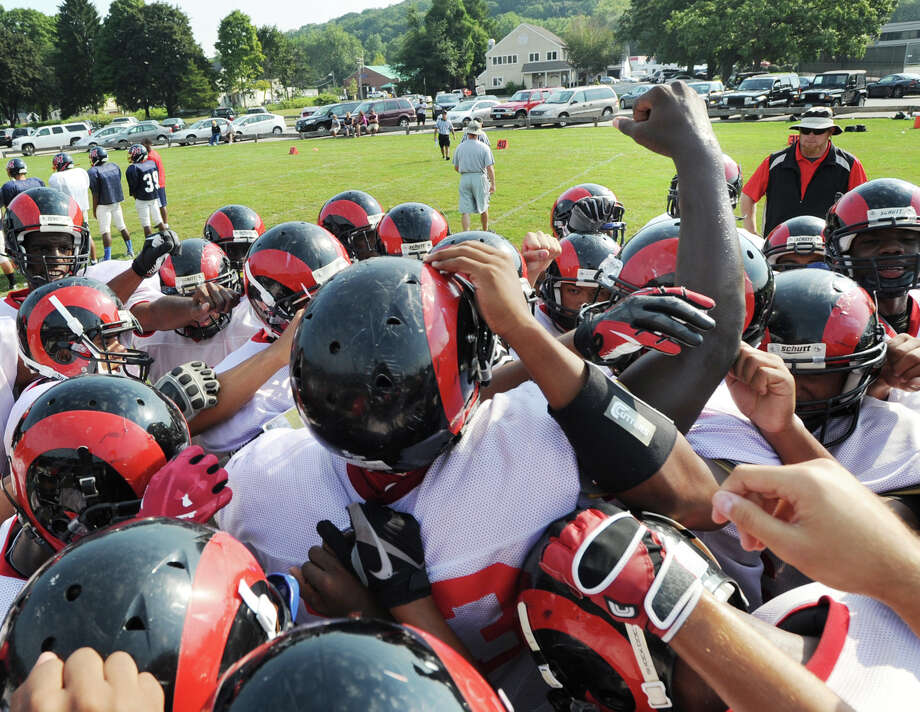Bridgeport Central High School running back, Andrew Louis, # 23, puts a fist in the air during a huddle at the start of the scrimmage against Brien McMahon High School during the high School football jamboree at Wilton High School, Saturday morning, Sept. 1, 2012. Photo: Bob Luckey / Greenwich Time