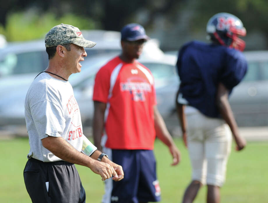 Bridgeport Central High School Head Football Coach, Dave Cadelina, left, coaches his team during the high School football jamboree at Wilton High School, Saturday morning, Sept. 1, 2012. Photo: Bob Luckey / Greenwich Time
