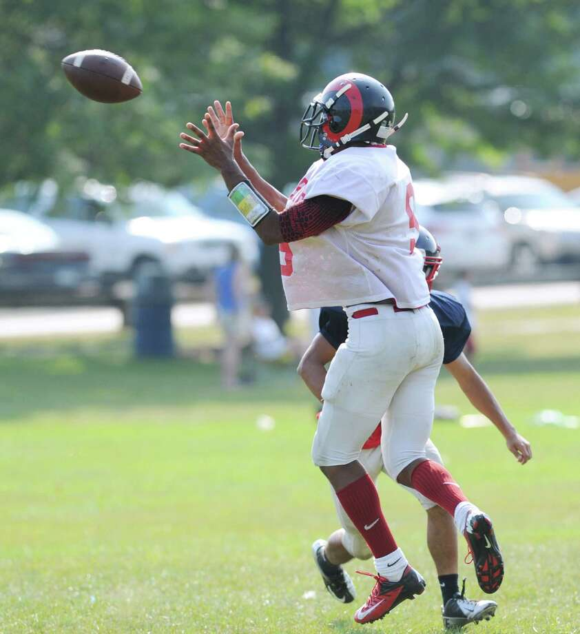 Bridgeport Central High School wide receiver Mykel Morris # 9, makes a reception in the scrimmage against Brien McMahon High School during the high School football jamboree at Wilton High School, Saturday morning, Sept. 1, 2012. Photo: Bob Luckey / Greenwich Time
