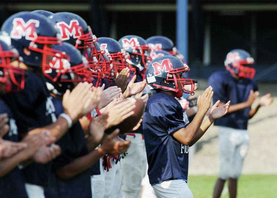 Brien McMahon High School football players during the high School football jamboree at Wilton High School, Saturday morning, Sept. 1, 2012. Photo: Bob Luckey / Greenwich Time