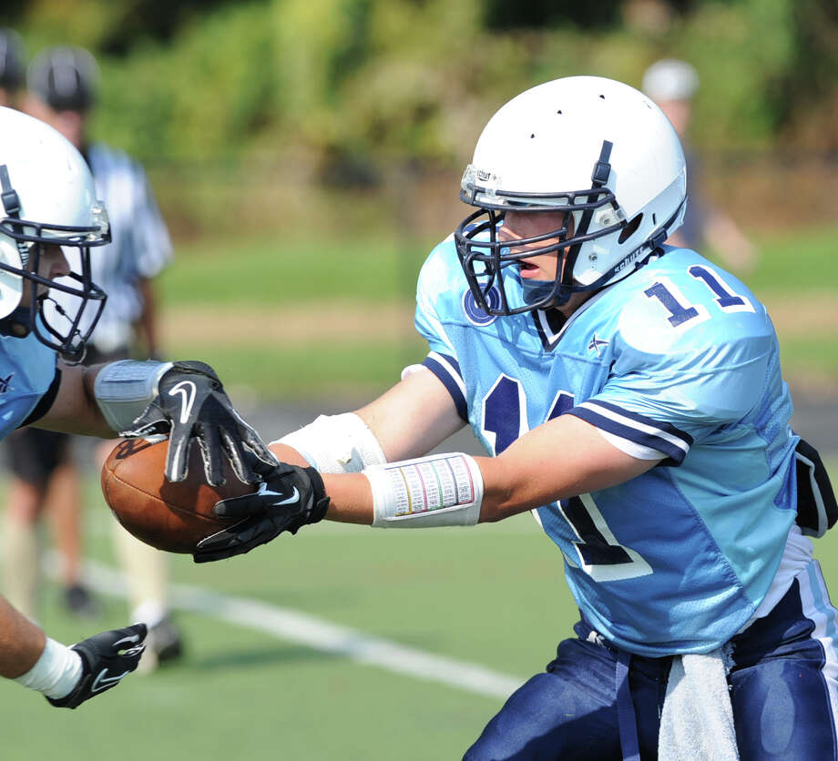 Wilton High School Quarterback Brett Phillips, right, during the high School football jamboree at Wilton High School, Saturday morning, Sept. 1, 2012. Photo: Bob Luckey / Greenwich Time