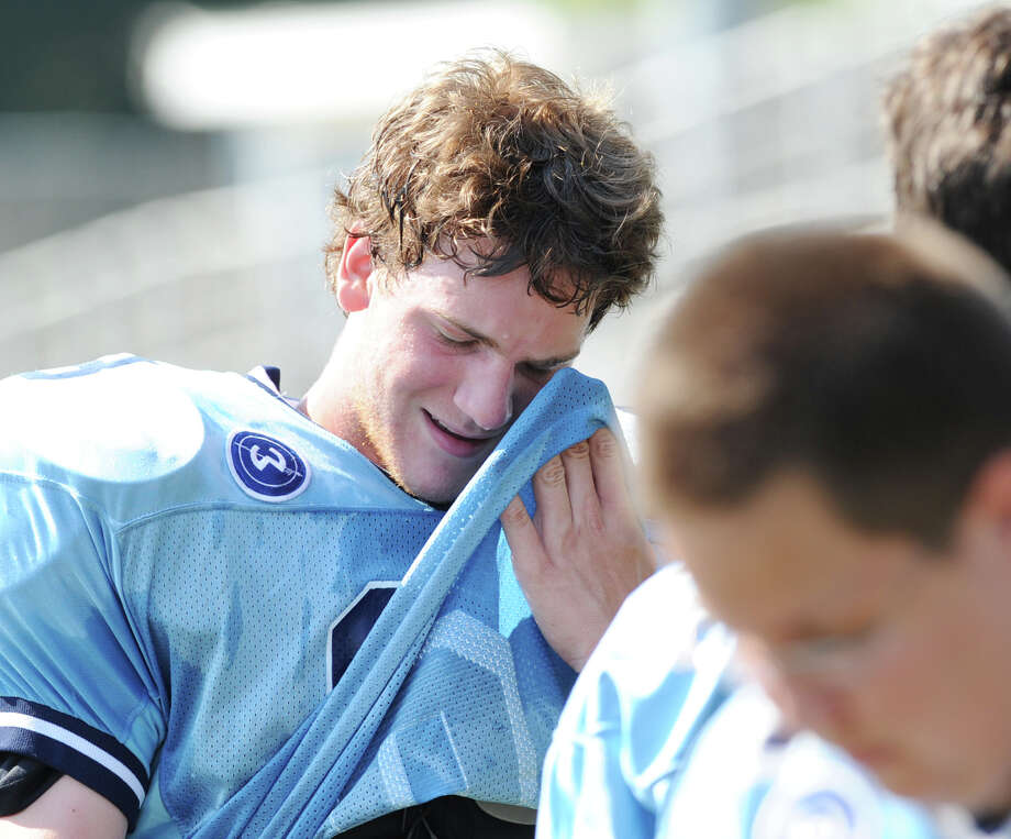 Football player Griffin Bender of Wilton High School wipes sweat from his brow during the high School football jamboree at Wilton High School, Saturday morning, Sept. 1, 2012. Photo: Bob Luckey / Greenwich Time