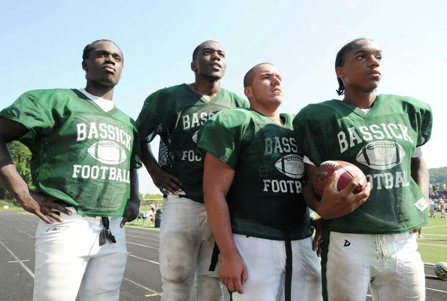 Bassick High School Football captains from left, A. J. Brown, Dale Kirkland, Luis Acosta, and Vochan Fowler during the high School football jamboree at Wilton High School, Saturday morning, Sept. 1, 2012. Photo: Bob Luckey / Greenwich Time