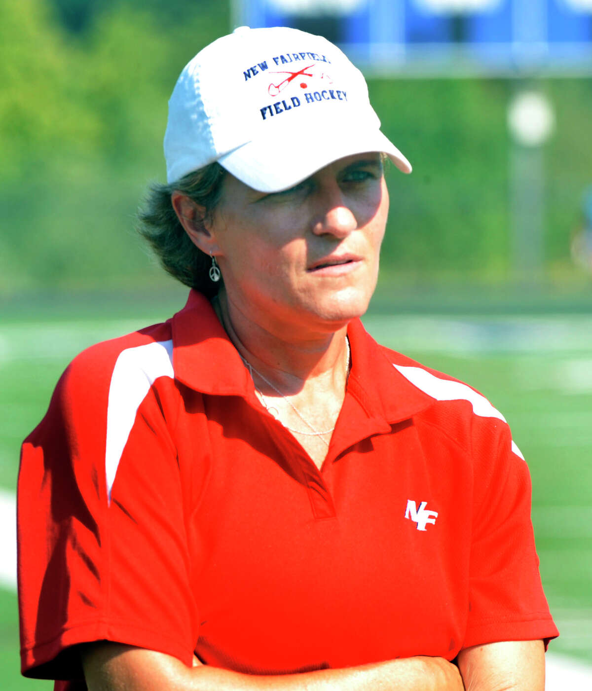 Karen Nell coaches New Fairfield at the Mustang Mix-up Field Hockey Jamboree in Danbury Saturday, Sept. 1, 2012.