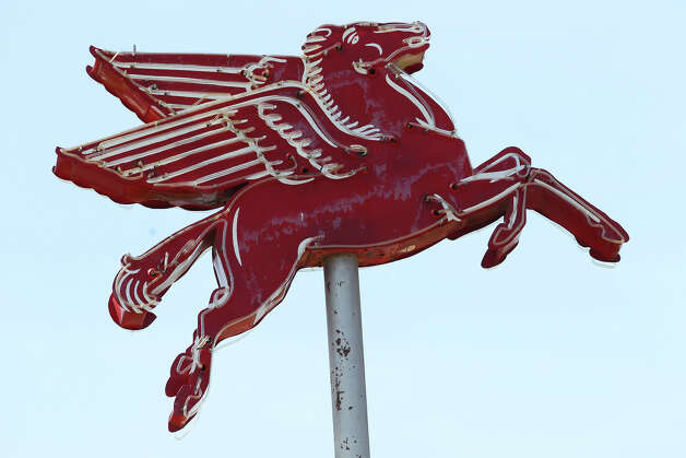 A classic Mobil Oil Pegasus with neon still tops the old Mobil gas station at 5424 Broadway at the corner of Austin Highway. The structure has been occupied by various retailers since ceasing operations as a filling station. Photo: John Davenport, San Antonio Express-News / San Antonio Express-News
