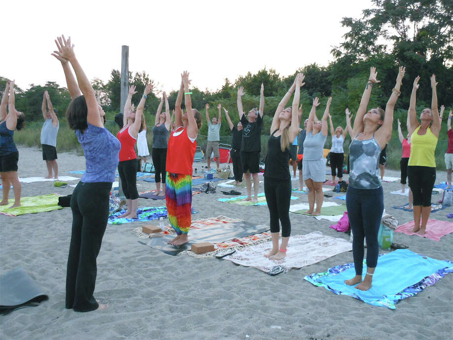 LifePath Yoga & Wellness will hold a beach yoga session at Calf Pasture Beach in Norwalk onSaturday Photo: Mike Lauterborn / Fairfield Citizen contributed