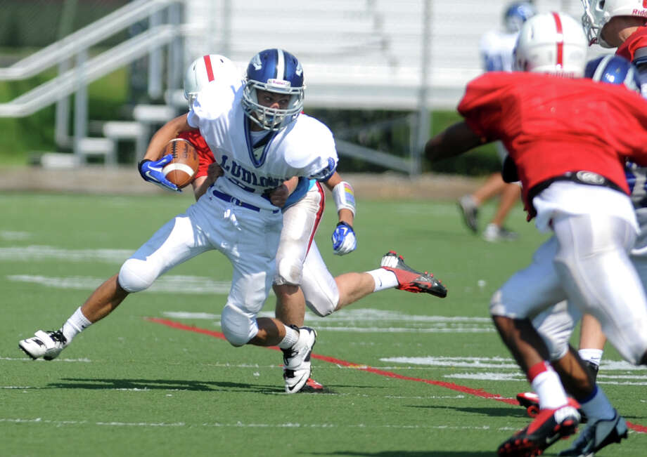 Fairfield Ludlowe High School's Danny Santella tries to escape a tackle during a preseason scrimmage against Fairfield Prep Saturday, Sept. 1, 2012 at Alumni Field in Fairfield, Conn. Photo: Autumn Driscoll / Connecticut Post