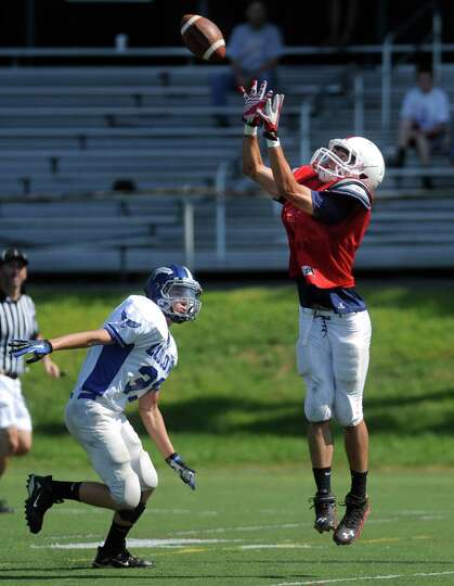Fairfield Prep's Dave Gerics catches the ball during a preseason scrimmage against Fairfield Ludlowe