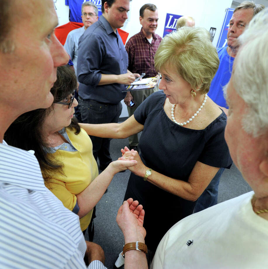 Linda McMahon, right center, greets supporters at the opening of her campaign office on Mill Plain Road in Danbury, Friday, Aug. 10, 2012. McMahon is a Republican candidate for the U.S. Senate. Photo: Carol Kaliff / The News-Times