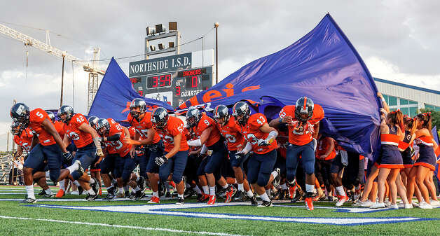 The Brandeis Broncos take the field prior to their season opener with Smithson Valley at Farris Stadium on Aug. 31, 2012.  MARVIN PFEIFFER/ mpfeiffer@express-news.net Photo: MARVIN PFEIFFER, Express-News / Express-News 2012