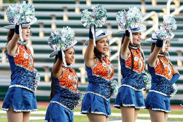 Members of the Brandeis Lariettes Dance Team sing the school song prior to their season opener with Smithson Valley at Farris Stadium on Aug. 31, 2012.  MARVIN PFEIFFER/ mpfeiffer@express-news.net Photo: MARVIN PFEIFFER, Express-News / Express-News 2012