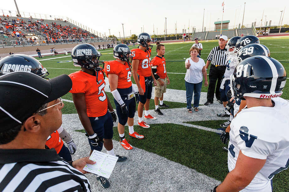 NISD Board President Karen Freeman (center) does the coin flip prior to the season opener for Brandeis and Smithson Valley at Farris Stadium on Aug. 31, 2012.  MARVIN PFEIFFER/ mpfeiffer@express-news.net Photo: MARVIN PFEIFFER, Express-News / Express-News 2012