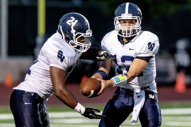 Smithson Valley running back Lawrence Mattison prepares to take a handoff from quarterback Garrett Smith during the Rangers' season opener with Brandeis at Farris Stadium on Aug. 31, 2012.  Smithson Valley won the game 41-7.  MARVIN PFEIFFER/ mpfeiffer@express-news.net Photo: MARVIN PFEIFFER, Express-News / Express-News 2012