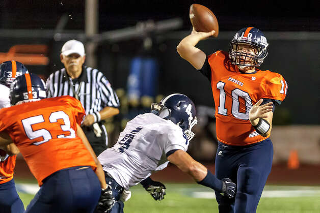 Brandeis quarterback Brian Chapman (right) gets a pass off as Smithson Valley linebacker George Schwanenberg applies pressure during the season opener for both teams at Farris Stadium on Aug. 31, 2012.  Smithson Valley won the game 41-7.  MARVIN PFEIFFER/ mpfeiffer@express-news.net Photo: MARVIN PFEIFFER, Express-News / Express-News 2012