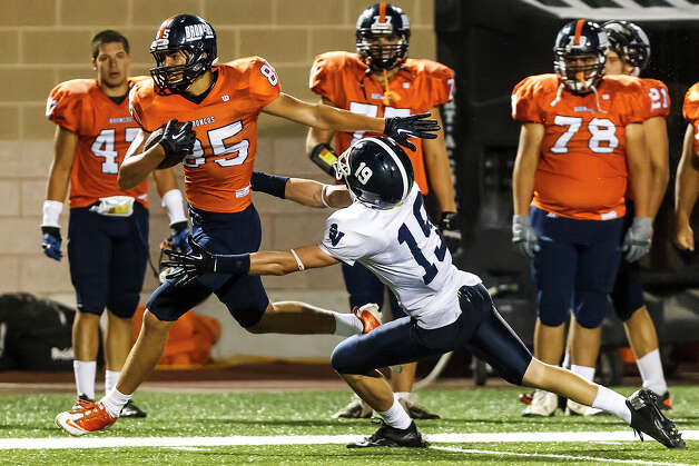 Brandeis wide receiver Andrew Heft races down the sideline for a first down as Smithson Valley's Austi Pierce tries to bring him down during the season opener for both teams at Farris Stadium on Aug. 31, 2012.  Smithson Valley won the game 41-7.  MARVIN PFEIFFER/ mpfeiffer@express-news.net Photo: MARVIN PFEIFFER, Express-News / Express-News 2012
