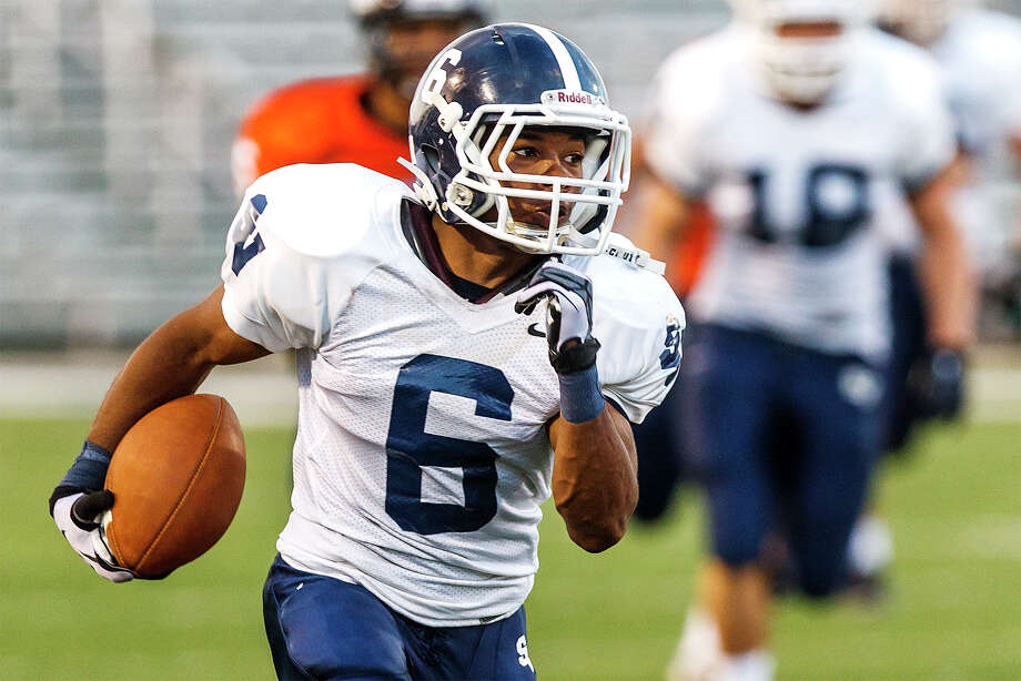 Smithson Valley running back Xavier Coombs scores a touchdown on a 72-yard reception during the first quarter against Brandeis in the season opener for both teams at Farris Stadium on Aug. 31, 2012.  Smithson Valley won the game 41-7.  MARVIN PFEIFFER/ mpfeiffer@express-news.net Photo: MARVIN PFEIFFER, Express-News / Express-News 2012