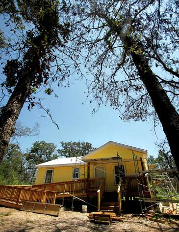 A home rebuilt through effort of the Bastrop Long Term Recovery Team is seen Monday Aug. 20, 2012. The one year anniversary of the Bastrop Fire Complex fire that burned much of Bastrop State Park and the so-called Lost Pines area of central Texas is Sept. 4. Photo: William Luther, San Antonio Express-News / © 2012 San Antonio Express-News