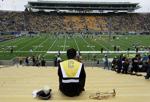 Trumpet player Isaac Tian saves seats for his fellow Cal band members before the game against Nevada at the renovated Memorial Stadium, which now includes three stories of high-priced club seats and a state-of-the-art press box. Photo: Paul Chinn, The Chronicle