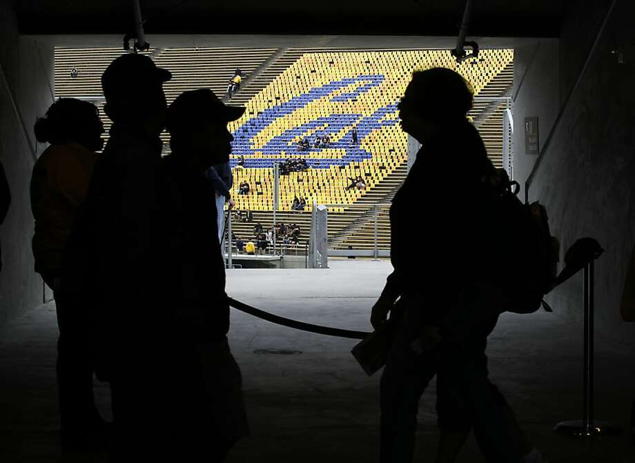 Fans walk to their seats in the remodeled concourse level before the first Cal Bears game at the renovated Memorial Stadium against the Nevada Wolfpack in Berkeley, Calif. on Saturday, Sept. 1, 2012. Photo: Paul Chinn, The Chronicle