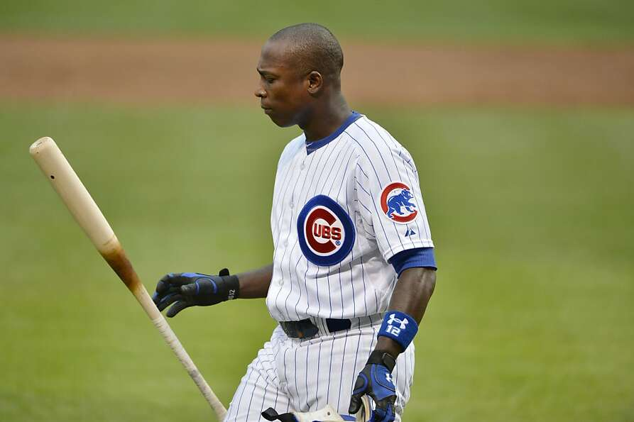 Alfonso Soriano #12 of the Chicago Cubs flips his bat after striking out during the first inning aga