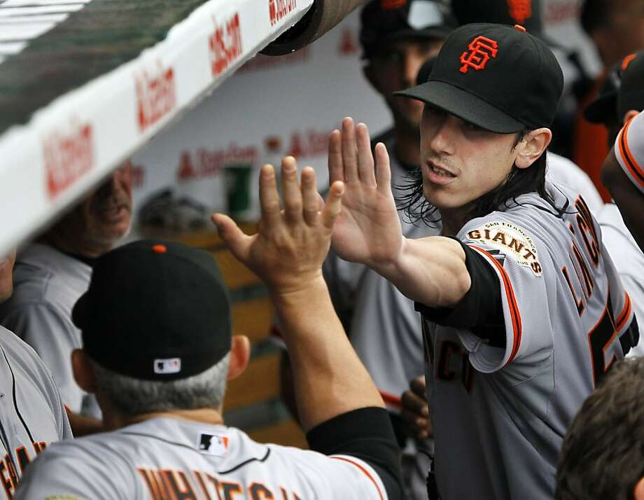 San Francisco Giants starting pitcher Tim Lincecum, right, is greeted in the dugout after leaving the game during the seventh inning of a baseball game against the Chicago Cubs Saturday, Sept. 1 2012, in Chicago. (AP Photo/Charles Rex Arbogast) Photo: Charles Rex Arbogast, Associated Press