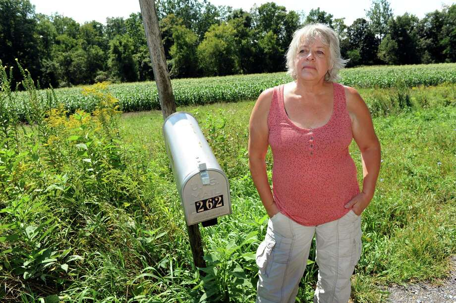 Joann Hoose talks about her farmer neighbor, who fires a loud propane cannon to scare birds from his sweet corn crops, on Tuesday, Aug. 28, 2012, in Feura Bush, N.Y. (Cindy Schultz / Times Union) Photo: Cindy Schultz / 00019040A