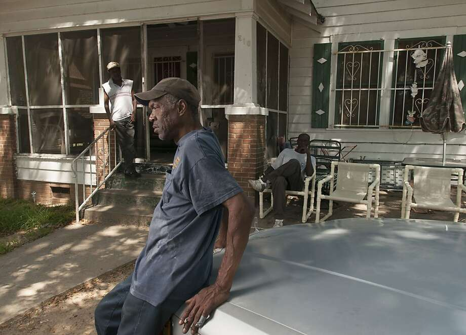 LaMichael James, raised by his grandmother in Texarkana, Texas, lived in her house alone in his senior year after her death; uncle Ronnie James (foreground) lives there now. Photo: Rex C Curry, Special To The Chronicle