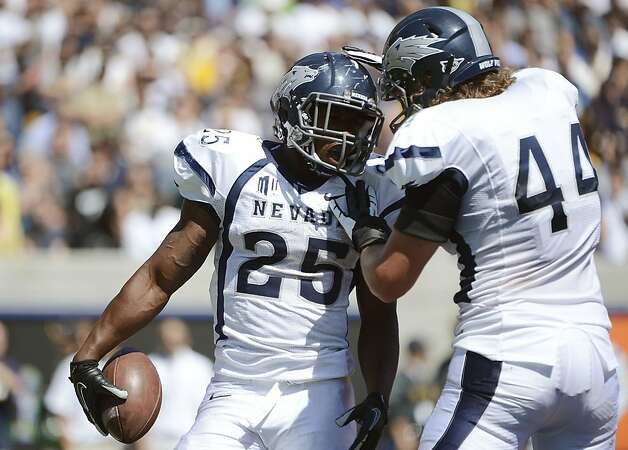 BERKELEY, CA - SEPTEMBER 01:  Stephon Jefferson #25 and Zach Sudfeld #44 of the University of Nevada celebrtates after Jefferson scores a touchdown against the University of California in the third quarter of an NCAA football game between the Nevada Wolf Pack and California Golden Bears at California Memorial Stadium on September 1, 2012 in Berkeley, California.  (Photo by Thearon W. Henderson/Getty Images) Photo: Thearon W. Henderson, Getty Images