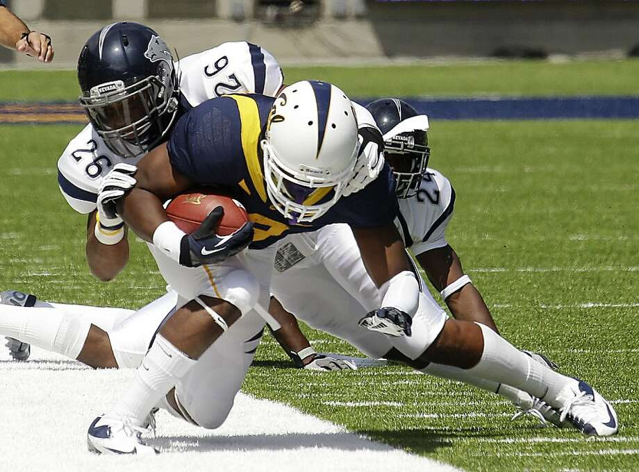 Nevada's Dray Bell (26) and Charles Garrett (24) knock California's C.J. Anderson out of bounds during the first half of an NCAA college football game, Saturday, Sept. 1, 2012, in Berkeley, Calif. (AP Photo/Ben Margot) Photo: Ben Margot, Associated Press