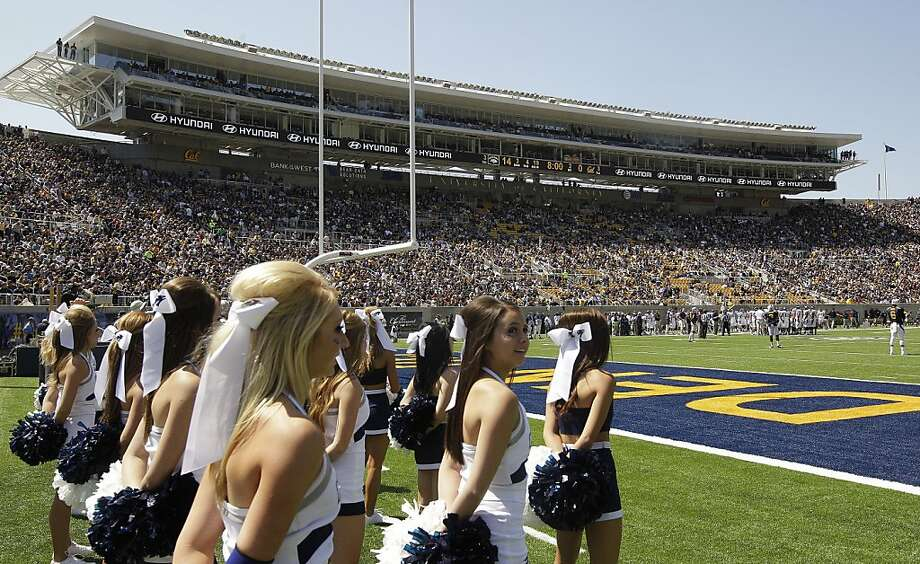 Nevada cheerleaders wait to perform in the newly-renovated Memorial Stadium during the first half of an NCAA college football game against California Saturday, Sept. 1, 2012, in Berkeley, Calif. (AP Photo/Ben Margot) Photo: Ben Margot, Associated Press