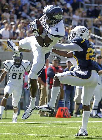 Nevada's Brandon Wimberly, left, makes a reception in front of California's Josh Hill during the second half of an NCAA college football game, Saturday, Sept. 1, 2012, in Berkeley, Calif. (AP Photo/Ben Margot) Photo: Ben Margot, Associated Press