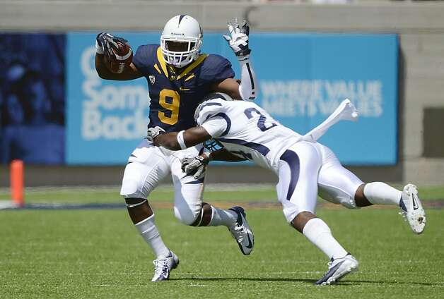 BERKELEY, CA - SEPTEMBER 01:  C.J. Anderson #9 California rushes with the ball and breaks the tackle of Charles Garrett #24 of Nevada in the first quarter of an NCAA football game between the Nevada Wolf Pack and the California Golden Bears at California Memorial Stadium on September 1, 2012 in Berkeley, California.  (Photo by Thearon W. Henderson/Getty Images) Photo: Thearon W. Henderson, Getty Images