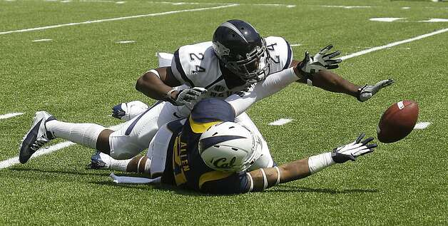 Nevada's Charles Garrett (24) forces an incomplete pass intended for California wide receiver Keenan Allen during the first half of an NCAA college football game Saturday, Sept. 1, 2012, in Berkeley, Calif. (AP Photo/Ben Margot) Photo: Ben Margot, Associated Press