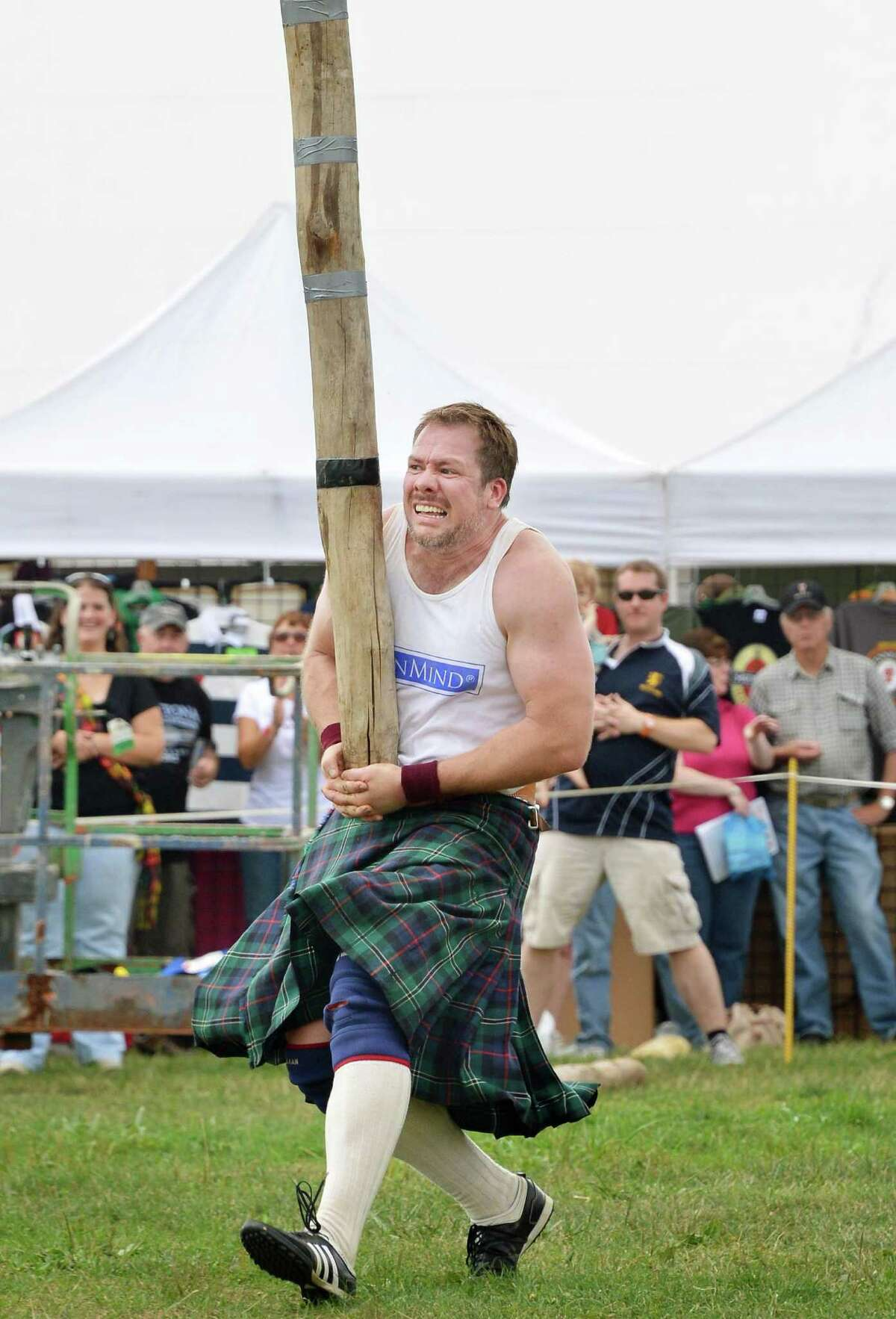 Dave Barron of Syracuse tosses the caber during the Scottish Games at the Altamont Fairgrounds Saturday Sept. 1, 2012. (John Carl D'Annibale / Times Union)