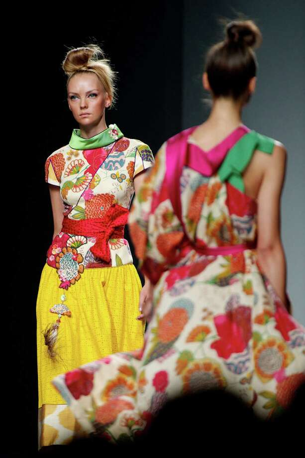 Models walk the runway in the Victorio & Lucchino fashion show. Photo: Carlos Alvarez, Getty Images / 2012 Getty Images