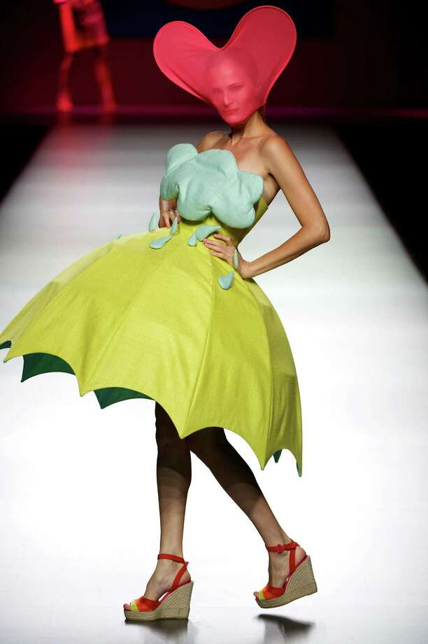 A model walks the runway in the Agatha Ruiz de la Prada fashion show. Photo: Carlos Alvarez, Getty Images / 2012 Getty Images