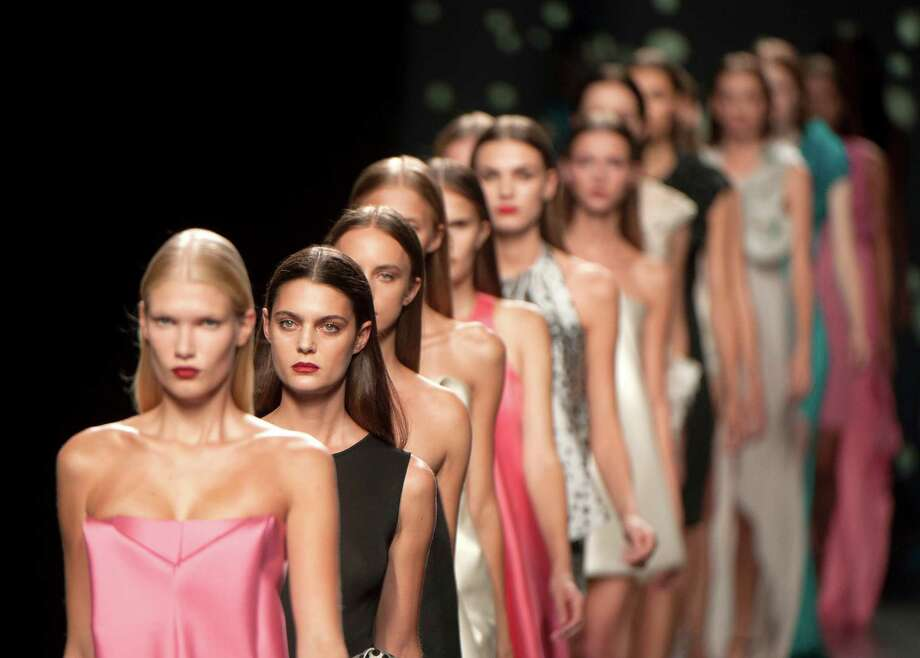 Models present outfits during the Amaya Arzuaga spring-summer 2013 collection show at Mercedes-Benz Madrid Fashion Week in Madrid on Sept. 1, 2012. This year's event is scheduled to run through Sept. 4. Photo: DANI POZO, AFP/Getty Images / 2012 AFP